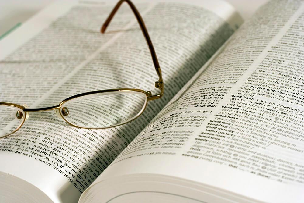 glasses-on-book-interpretation